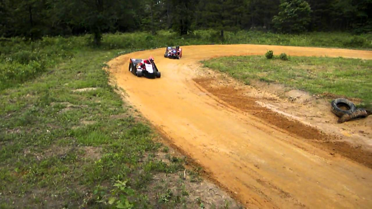 Back yard short high banked go kart racing youtube for House of tracks