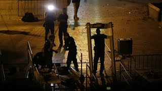 Israel scraps metal detectors at holy site after deadly unrest