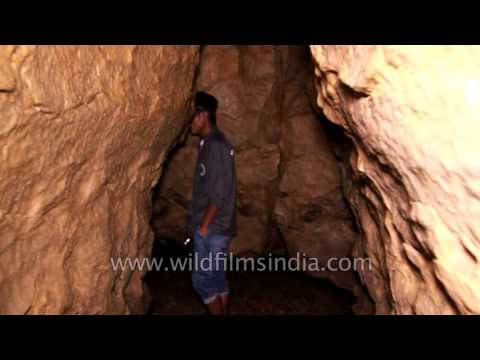 Visitors inside Lumshynna Cave in Cherrapunji