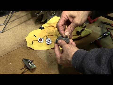 how to clean small outboard carburetor