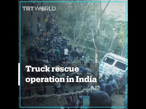 Indian villagers rescue truck from 21-metre gorge