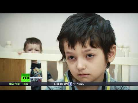 Russian orphans whose parents were killed in Iraq arrive in Moscow