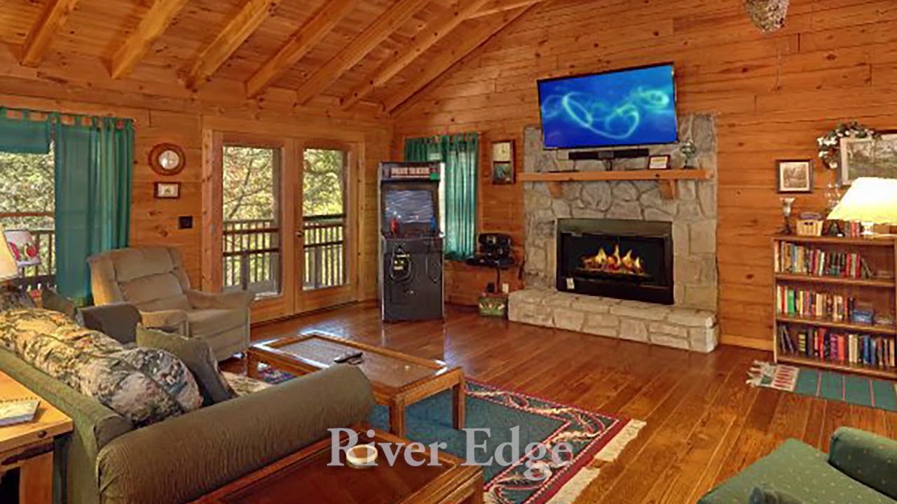 rustic sofa tennessee love gatlinburg sleeper cozy bedroom can and vacation it mountain owner private sits seat fireplace in room so above be tv living tn home with the leather cabin holiday valley a wears cabins rentals smoky
