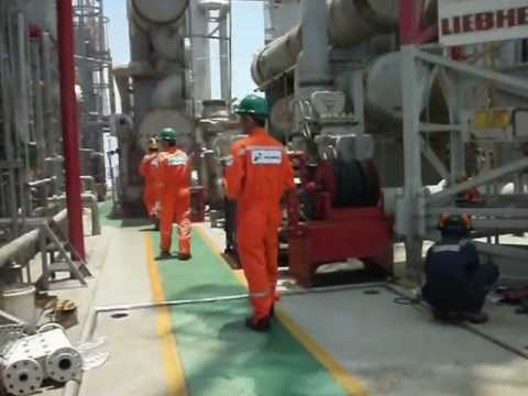 People Working on an Offshore Oil Platform in Indonesia (repairing a glycol pump)