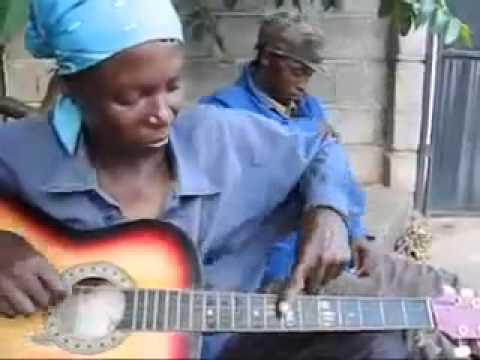 :) Amazing Woman from Botswana plays a guitar