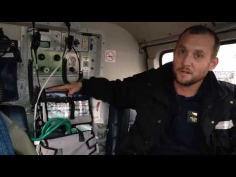 Helicopter Flight Medic Explaining His Equipment In A AS350B2