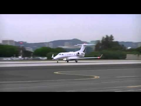 Netjets Embraer Phenom 300 take-off from Santa Monica airport