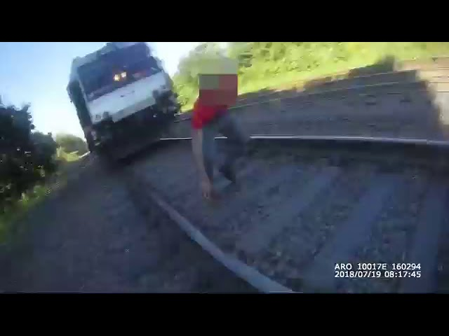 NJ cop runs to save life — train stops within inches!