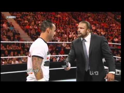 CM Punk's hits Triple H with a pipe bomb after mic cutoffs