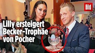 Lilly ersteigert Becker-Trophäe von Pocher | 10000 € für guten Zweck