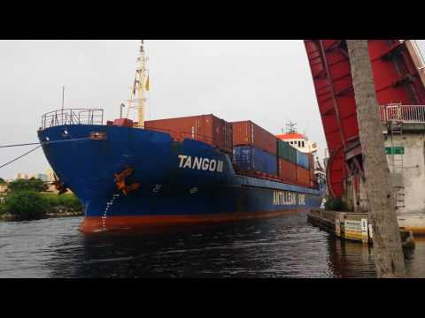 Drawbridge Opens for Freighter and Tugboats