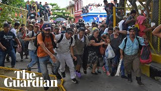 Migrant caravan in Guatemala breaks through border fence into Mexico