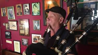 Playing the pipes inside an Irish bar