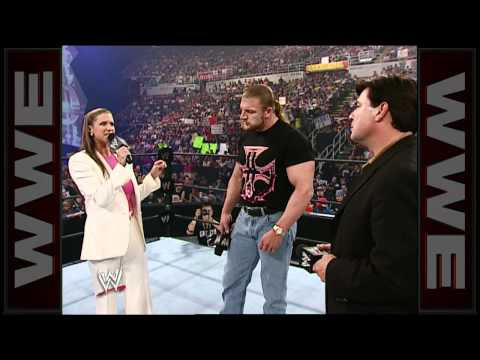 Stephanie McMahon and Eric Bischoff vie for the contract of