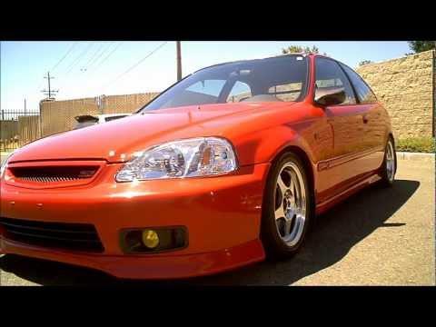 1999 Honda Civic EK Hatch on Polished Rota Slipstreams w/ CF Mirrors, rear wing, and Red Recaro's