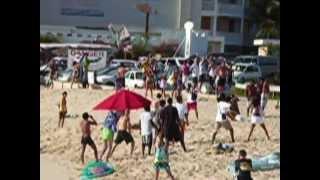 St. Maarten_ a red umbrella gets blown away
