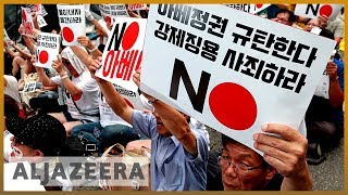 South Koreans rally against Japan amid bitter trade war