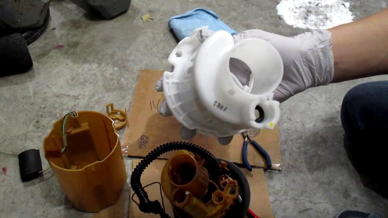 2004 kia rio fuel filter location