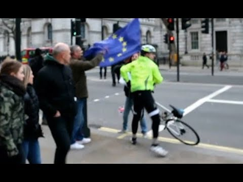 Pro Brexit protesters steal EU flag from cyclist in London
