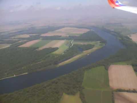 Aerial of River and Farms in Nebraska Landing into Omaha, NE