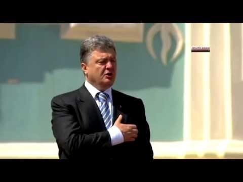 New Ukraine president Poroshenko takes oath in military style