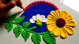Beautiful and innovative flowers rangoli design using spoon