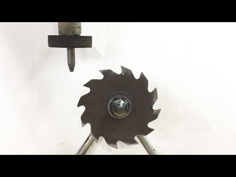 Saw Blade Fidget Spinner Powered By 60000 PSI Waterjet - water cutting metal