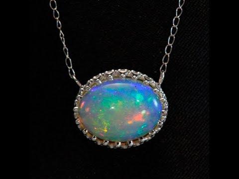 Opal pendant in 14 karat white gold 12 x 10 millimeter youtube opal pendant in 14 karat white gold 12 x 10 millimeter aloadofball Image collections