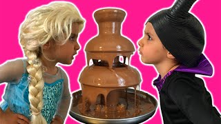 elsa vs maleficent real life disney princess movie chocolate fountain candy 10 surprise eggs