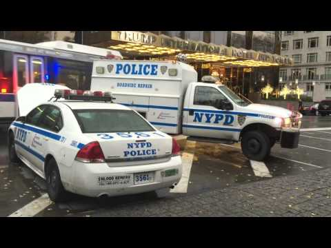 RARE CATCH OF THE NYPD ROADSIDE REPAIR UNIT CONDUCTING REPAIRS ON A CRUISER IN MANHATTAN, NYC.