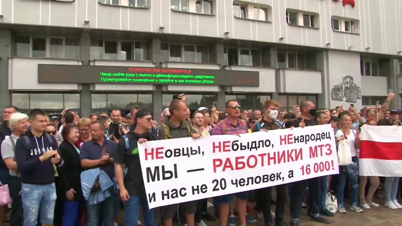 Crowds of workers walk out at Belarus factories in support of opposition | AFP