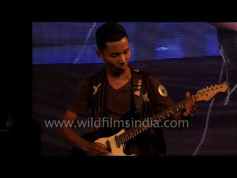 Lanchao Inpui plays guitar at 5th annual meet of North East Students' Society, Delhi