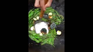Frying Green Chilis with Garlic looks so yummy with his Food Eating