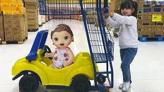 Cute Kid doing shopping with her favorite Baby Born Doll Video for children and toddlers laurinha