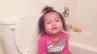 Baby first time on toilet