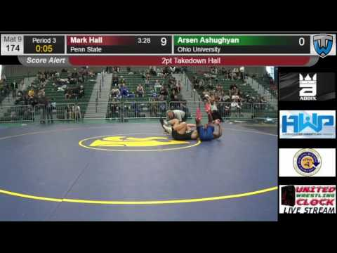 Mark Hall scores a pin in his first college tournament