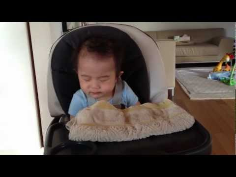 Baby in Food Coma sitting on Graco High Chair