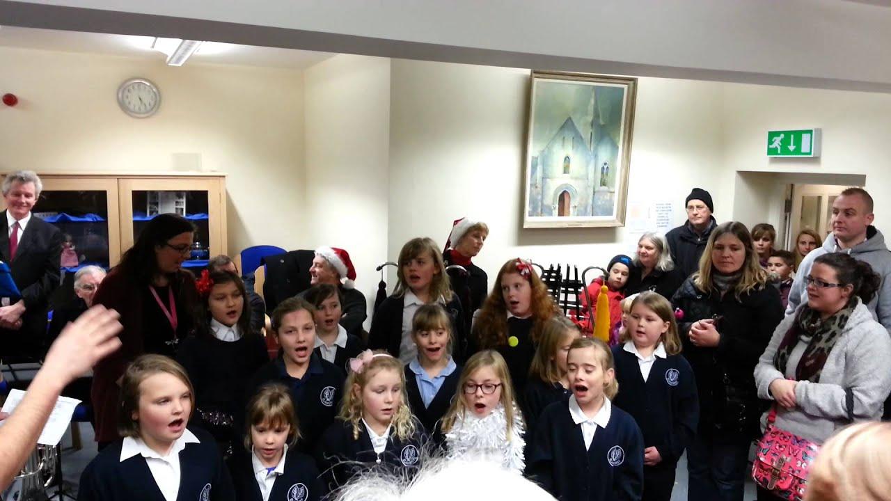 elmhurst junior school choir at street christmas lights
