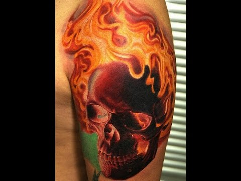 Skulls with flames tattoos youtube for Tattoo pictures of flames