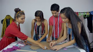 Indian students working together as a team on a design pattern - fashion studio