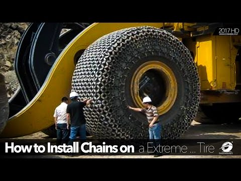 HEAVY !! HOW TO Install Chains on $60,000 Extreme Tyre Equipment Heavy Construction