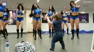 Hilarious toddler busts some dance moves at cheerleader practice
