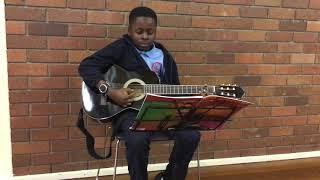 Kunmi performing on Guitar !