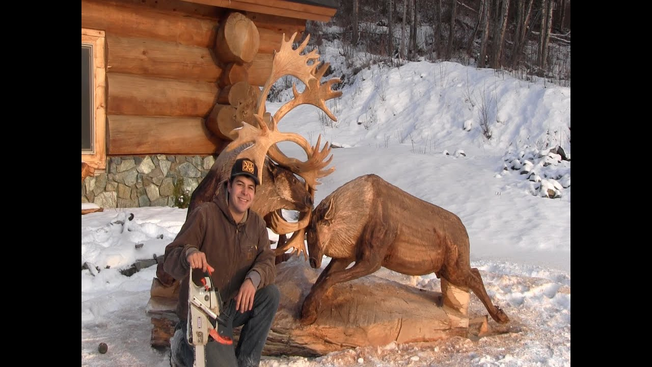 Fighting caribou chainsaw carving by jordan anderson doovi