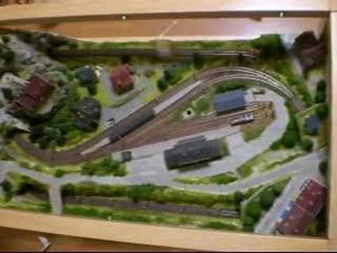 z scale freight train in coffee table layout - youtube