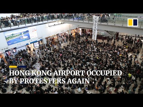 Extradition bill protesters return to Hong Kong International Airport to 'greet' arriving passengers