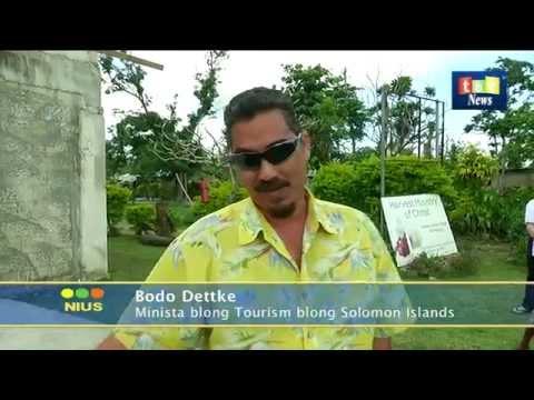 TBV News SI Minister Bodo Dettke donating iron roofing