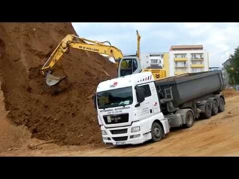 New Holland and Man TGX in action on construction