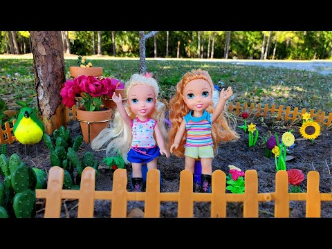 Gardening ! Elsa & Anna toddlers plant flowers outdoors