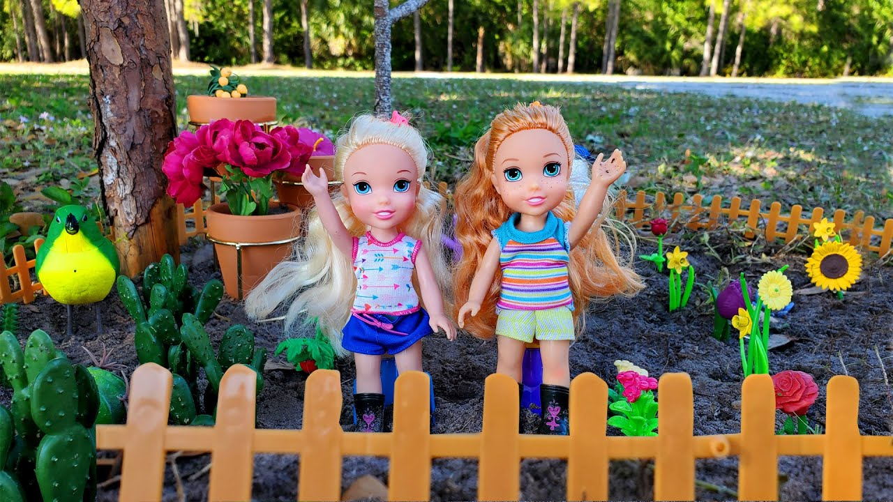 Download Gardening ! Elsa & Anna toddlers plant flowers outdoors